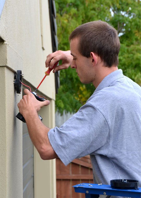 Jenco Electrical staff wiring a outside light